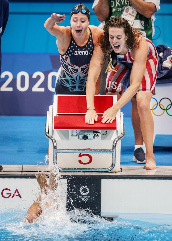 U.S. teammates Paige Madden, left, and Allison Schmitt cheer on Katie Ledecky in the final of the 800-meter relay.