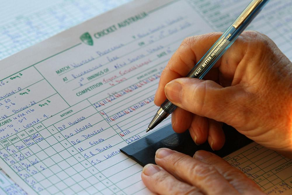 A scorer completes the days match score sheet during day three of the Futures League match between Western Australia and New South Wales at Richardson Park on October 16, 2013 in Perth, Australia.  (Photo by Paul Kane/Getty Images)