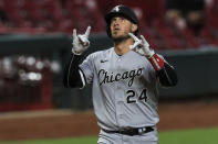 Chicago White Sox's Yasmani Grandal reacts after hitting a solo home run in the eighth inning during a baseball game against the Cincinnati Reds in Cincinnati, Saturday, Sept. 19, 2020. (AP Photo/Aaron Doster)