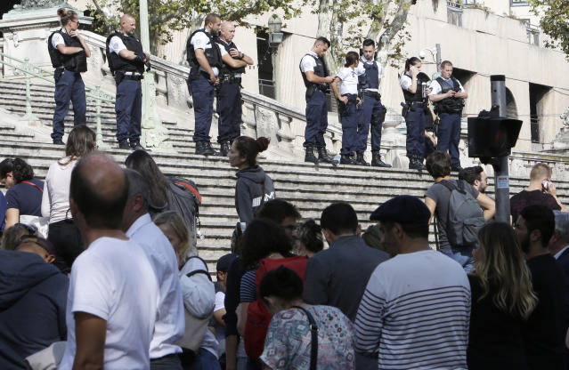 <p>Passengers wait in front a line a police officers blocking the access to Marseille 's main train station, Oct. 1, 2017 in Marseille, southern France. French police have warned people to avoid Marseille's main train station following a knife attack that made at least one dead. (AP Photo/Claude Paris) </p>
