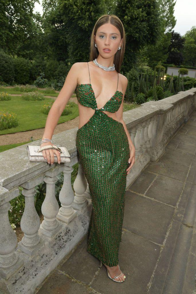 """<p>Iris Law, 20, glittered in vintage Roberto Cavalli for a Bulgari event at Spencer House. The actor would have been only three when the extreme cut-out maxi dress debuted on the runway during the AW/04 collection, but the green column dress looks like it was made for her.</p><p><a class=""""link rapid-noclick-resp"""" href=""""https://www.farfetch.com/uk/shopping/women/roberto-cavalli/items.aspx"""" rel=""""nofollow noopener"""" target=""""_blank"""" data-ylk=""""slk:SHOP ROBERTO CAVALLI NOW"""">SHOP ROBERTO CAVALLI NOW</a></p>"""