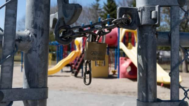 A gate is locked at St. Leonard School in Manotick, which closed last week due to a COVID-19 outbreak. Ottawa's medical officer of health says it's looking likely that schools will not be allowed to reopen after this week's spring break.