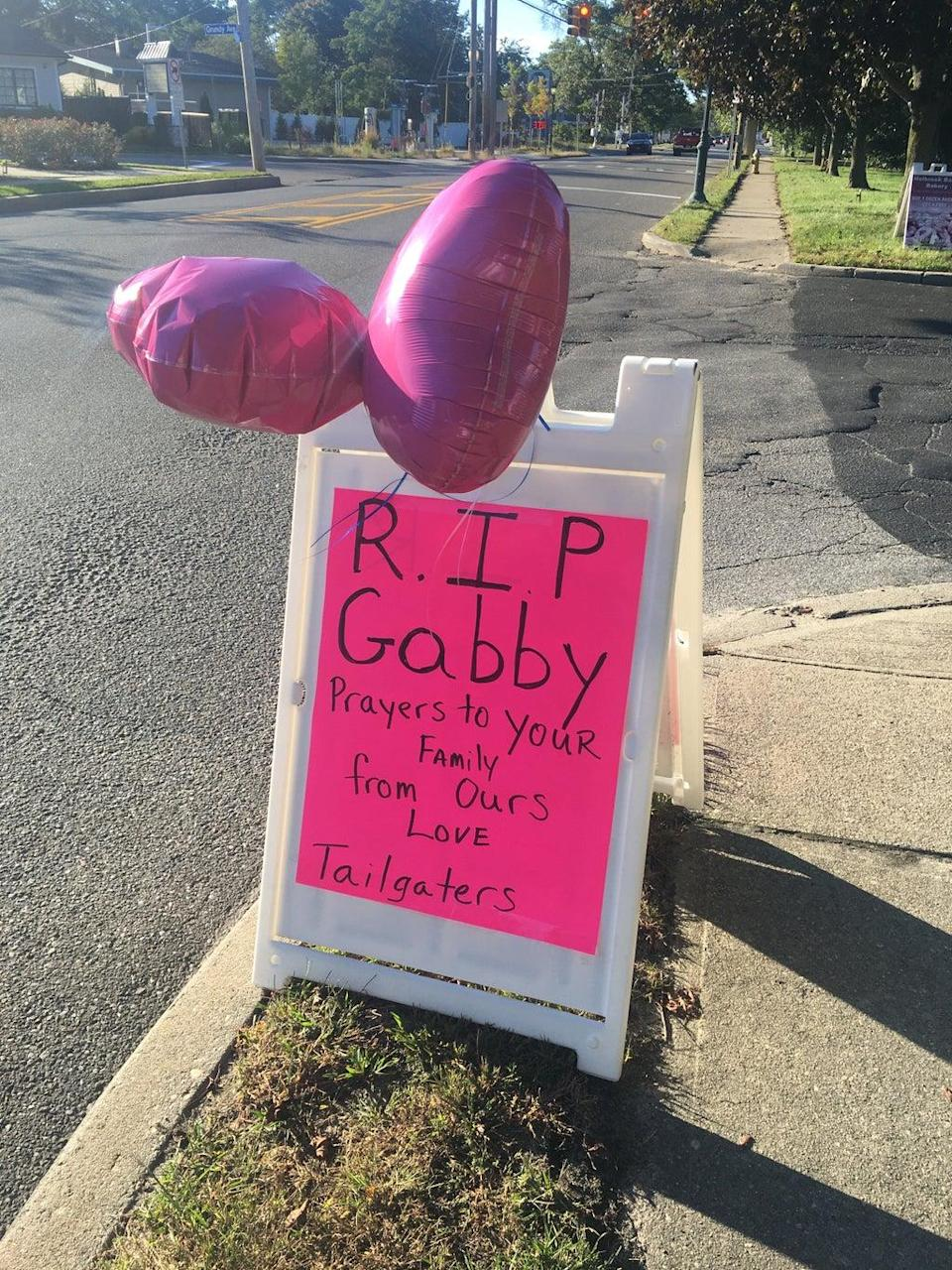 The Tailgaters bar in Holbrook, Long Island, left a tribute to Ms Petito on the side of the road near the memorial service (Bevan Hurley/The Independent)