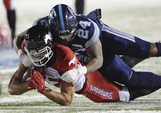 Calgary Stampeders quarterback Bo Levi Mitchell (19) passes against the Toronto Argonauts during the second half of a CFL football game in the Grey Cup in Ottawa on Sunday, Nov. 26, 2017. (Ryan Remiorz/The Canadian Press via AP)