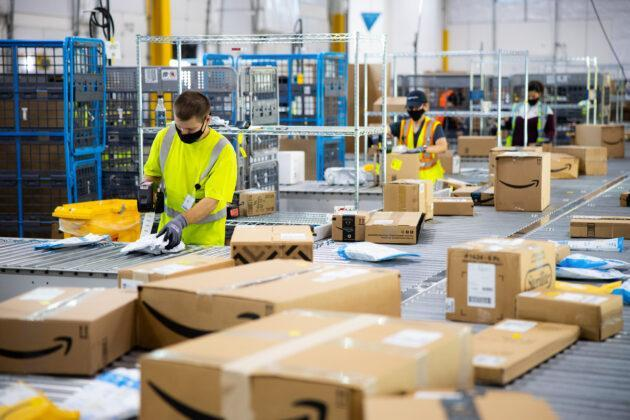 Workers in an Amazon distribution center. (Amazon Photo)