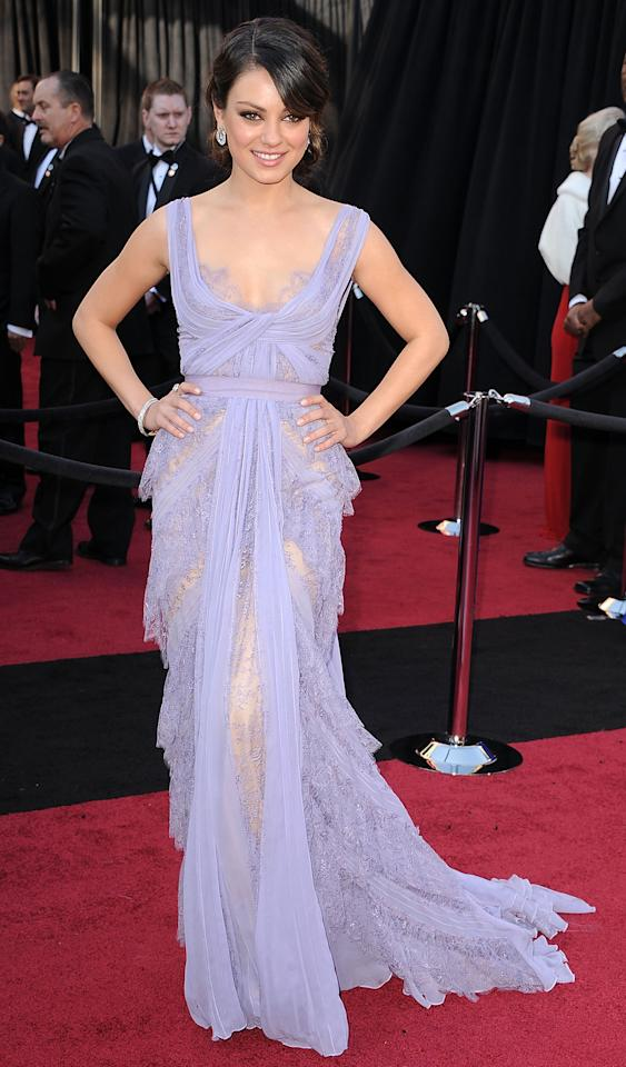 But Kunis really broke out the lace when she wore this lavender Atelier Versace gown made especially for her at the 2011 Oscars. Why can't there be a statuette for Best Dressed of the Night? (2/27/2011)
