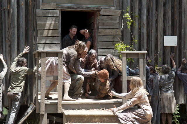"Rick Grimes (Andrew Lincoln), Daryl Dixon (Norman Reedus) and walkers in ""The Walking Dead"" episode, ""When the Dead Come Knocking."""