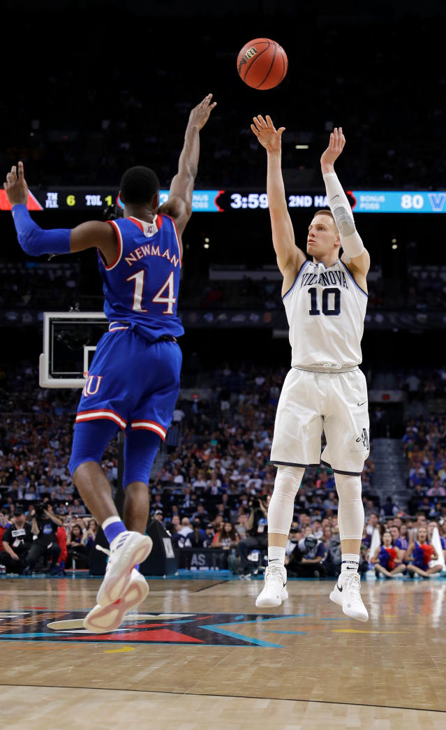 Villanova's Donte DiVincenzo (10) shoots a 3-point basket against Kansas's Malik Newman (14) during the second half in the semifinals of the Final Four NCAA college basketball tournament, Saturday, March 31, 2018, in San Antonio. (AP Photo/David J. Phillip)