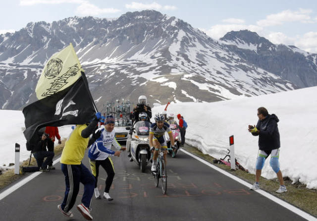 Thomas De Gendt of Belgium climbs on his way to win the 219 km 20th stage from Caldes to Passo dello Stelvio of the Tour of Italy Giro d'Italia May 26, 2012. AFP PHOTO / POOL / Alessandro GarofaloALESSANDRO GAROFALO/AFP/GettyImages