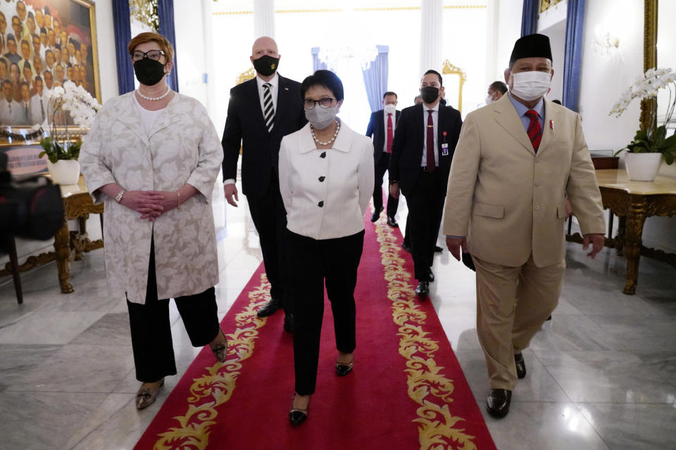 In this photo released by the Indonesian Ministry of Foreign Affairs, Australian Foreign Minister Marise Payne, left, and Defense Minister Peter Dutton, rear left, walk with their Indonesian counterpart Retno Marsudi, center, and Prabowo Subianto, right, during their meeting in Jakarta, Indonesia, Thursday, Sept. 9, 2021. Australia's foreign and defense ministers are visiting Indonesia, India, South Korea and the United States to bolster economic and security relationships within the Asia-Pacific region, where tensions are rising with China. (Indonesian Ministry of Foreign Affairs via AP)