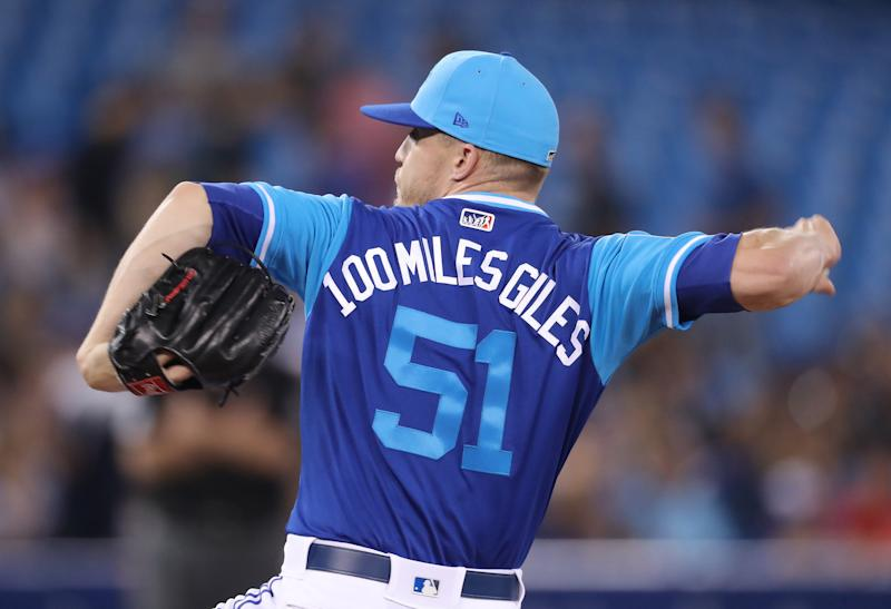 TORONTO, ON - AUGUST 24: Ken Giles #51 of the Toronto Blue Jays wears a nickname on the back of his jersey on Players Weekend as he delivers a pitch in the ninth inning during MLB game action against the Philadelphia Phillies at Rogers Centre on August 24, 2018 in Toronto, Canada. (Photo by Tom Szczerbowski/Getty Images)