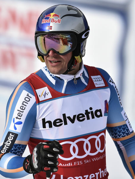 Aksel Lund Svindal of Norway reacts during the men's downhill training session at the alpine skiing World Cup finals in Lenzerheide, Switzerland, Tuesday, March 11, 2014. (AP Photo/Keystone, Peter Schneider)