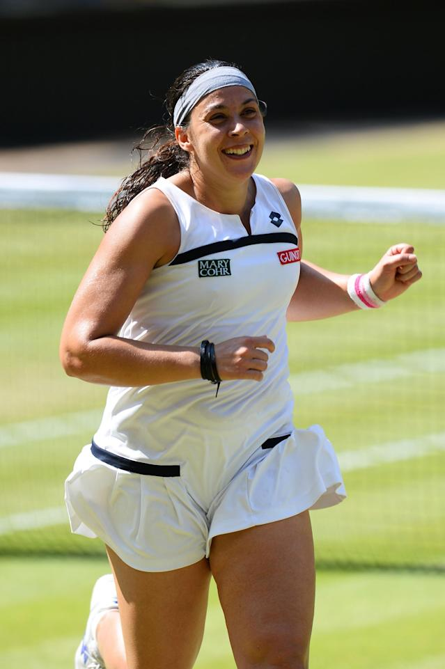 LONDON, ENGLAND - JULY 06: Marion Bartoli of France runs to her box as she celebrates victory after the Ladies' Singles final match against Sabine Lisicki of Germany on day twelve of the Wimbledon Lawn Tennis Championships at the All England Lawn Tennis and Croquet Club on July 6, 2013 in London, England. (Photo by Mike Hewitt/Getty Images)