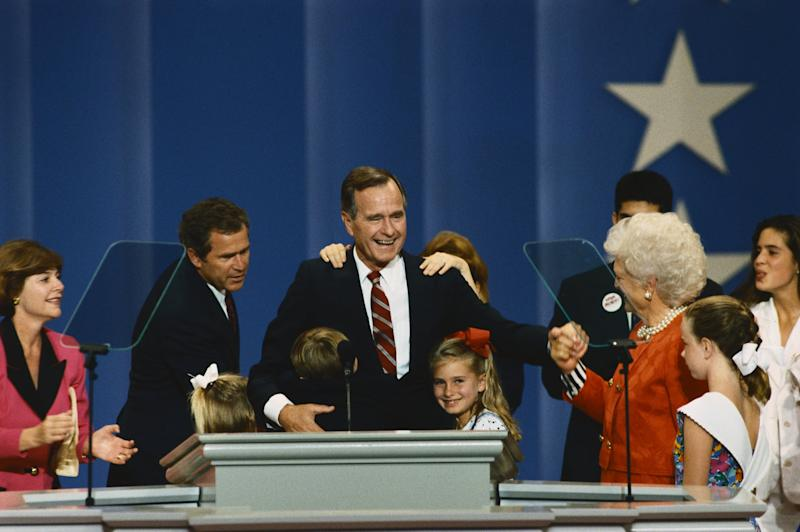 George Bush on the podium at the 1992 Republican National Convention. He is joined by (left to right) daugther-in-law Laura Bush, her husband George W., and her daughter Jenna, an unidentified grandson hugging the President, granddaughter Barbara, wife Barbara, and grandchildren George Prescott (behind Barbara), Lauren, and Noelle. (Photo by © Wally McNamee/CORBIS/Corbis via Getty Images)