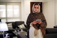 Afghan news anchor Beheshta Arghand poses for a photo at a temporary residence compound in Doha