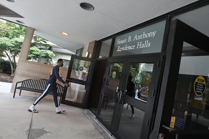 Yacine Sawadogo, a sophomore from Burkina Faso, heads into the Susan B. Anthony Residence Halls during the annual move-in day at the University of Rochester in New York.