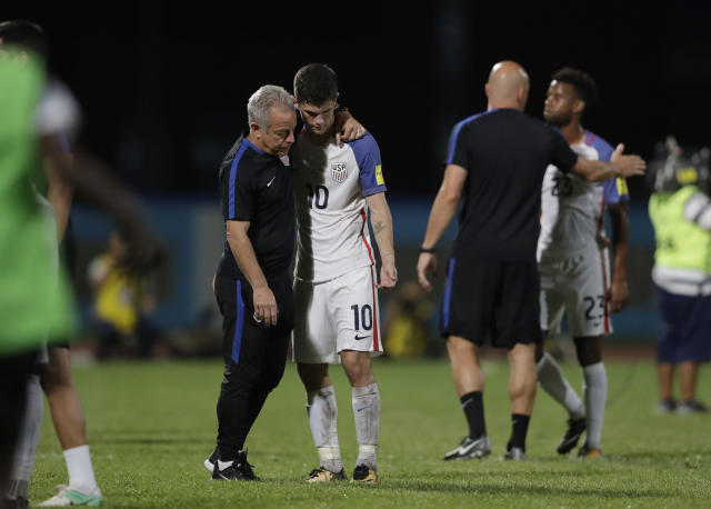 FILE - In this Oct. 10, 2017, file photo, United States' Christian Pulisic, (10) is comforted after losing 2-1 against Trinidad and Tobago during a 2018 World Cup qualifying soccer match in Couva, Trinidad. The United States will be missing from soccer's showcase after seven straight appearances. (AP Photo/Rebecca Blackwell, File)