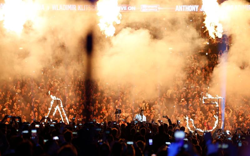 Anthony Joshua makes his entrance before the fight - Credit: Reuters / Andrew Couldridge