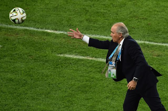 Argentina's coach Alejandro Sabella throws the ball onto the pitch during the final football match between Germany and Argentina for the FIFA World Cup at The Maracana Stadium in Rio de Janeiro on July 13, 2014 (AFP Photo/Gabriel Bouys)