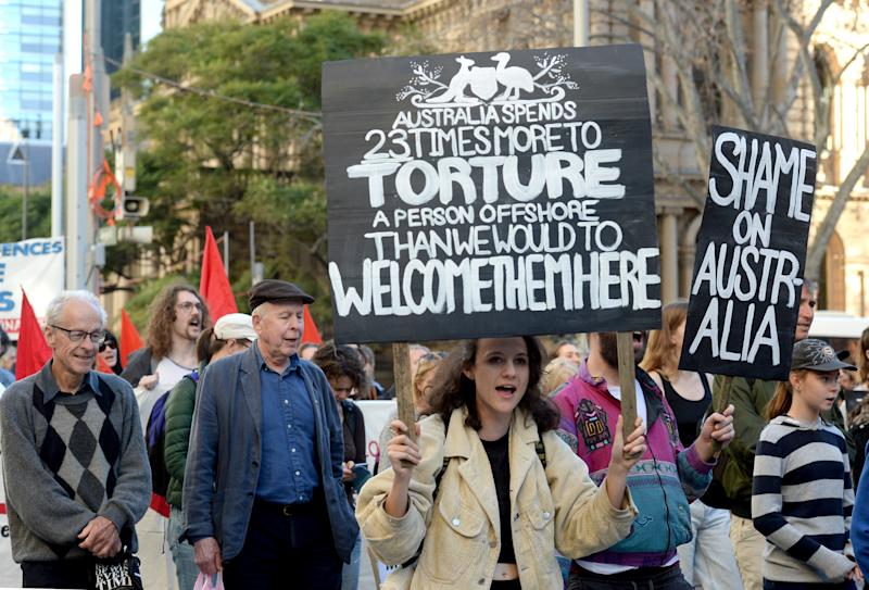 Protesters march through the central business district in Sydney marking six years since offshore detention on Manus and Nauru was implemented.