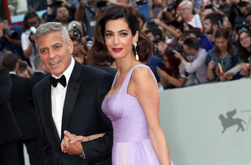 "George and Amal Clooney walk the red carpet before a screening of ""Suburbicon"" during the 74th Venice Film Festival. (Elisabetta A. Villa via Getty Images)"