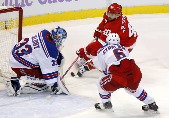 Detroit Red Wings center Henrik Zetterberg (40), of Sweden, takes a shot against New York Rangers goalie Cameron Talbot (33) and defenseman Anton Stralman (6), of Sweden, during the third period of an NHL hockey game Saturday, Oct. 26, 2013, in Detroit. The Rangers won 3-2. (AP Photo/Duane Burleson)