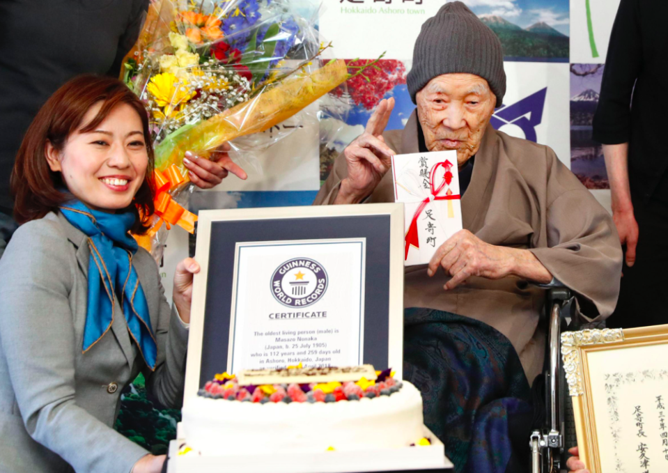 <em>The 112-year-old celebrated his record by tucking in to some cake (PA)</em>