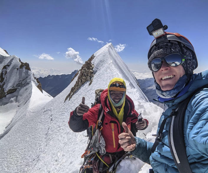 In this Aug. 22, 2021, photo released by Jean Granberg, her son Daniel Granberg, right, poses for a selfie with his guide, David, left, while climbing Huayna Potosi's French Route, or Via de Los Franceses near La Paz, Bolivia. The body of the American man, who died while climbing one of Bolivia's highest peaks, arrived Sunday, Sept. 5 in the country's capital after a two-day recovery effort. Rescue workers said 24-year-old Granberg, of Colorado, died atop the Illimani mountain.(Daniel Granberg/Jean Granberg family via AP)