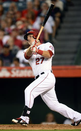 In this photo provided by Angels Baseball LP, Los Angeles Angels' Mike Trout follows through on a home run against the Boston Red Sox the third inning of a baseball game, Saturday, July 6, 2013, in Anaheim, Calif. (AP Photo/Angels Baseball LP, Matt Brown)