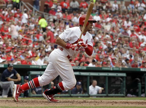St. Louis Cardinals' Jon Jay hits an RBI-double during the fourth inning of a baseball game against the Milwaukee Brewers, Sunday, May 19, 2013, in St. Louis. (AP Photo/Jeff Roberson)