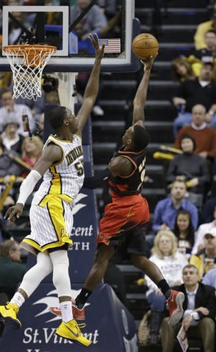 Atlanta Hawks' Shelvin Mack (8) puts up a shot against Indiana Pacers' Roy Hibbert (55) during the second half of an NBA basketball game Monday, March 25, 2013, in Indianapolis. The Pacers defeated the Hawks 100-94. (AP Photo/Darron Cummings)