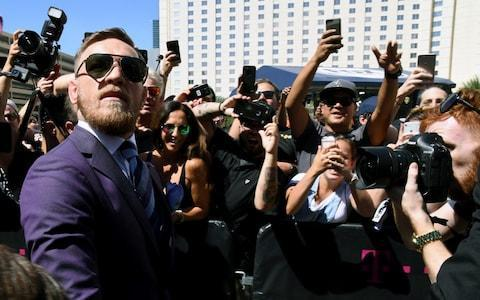 <span>Conor McGregor arrives at Toshiba Plaza</span> <span>Credit: Getty Images </span>