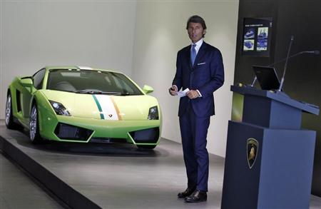 Stephan Winkelmann, CEO of Lamborghini, speaks with the media next to a Lamborghini Gallardo LP 550 during an opening ceremony of a new dealership, in New Delhi