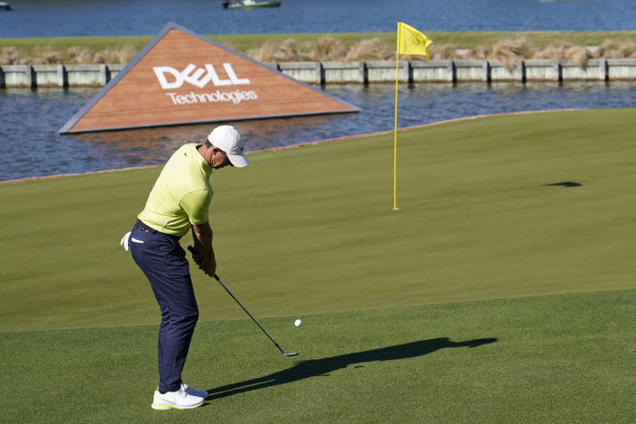Rory McIlroy of Northern Ireland hits onto the 13th green during a second round match at the Dell Technologies Match Play Championship golf tournament Thursday, March 25, 2021, in Austin, Texas. (AP Photo/David J. Phillip)