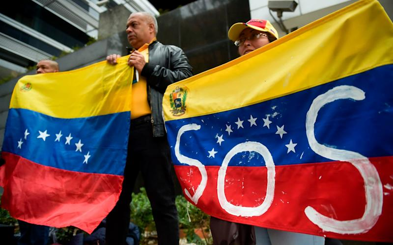 Protesters demand aid be allowed to Venezuela