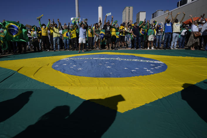 Supporters of Brazil's President Jair Bolsonaro shout during a pro-Bolsonaro rally at the Esplanade of Ministries, in Brasilia, Brazil, Sunday, Aug. 1, 2021. Political backers of President Bolsonaro have called for nationwide rallies to express their support for the embattled leader and his call for adding printouts to the electronic voting system. (AP Photo/Eraldo Peres)