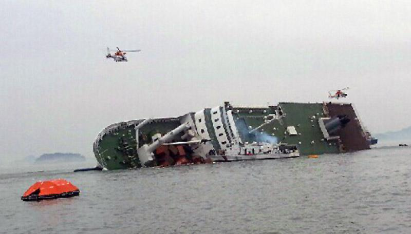 South Korean rescue helicopters fly over a South Korean passenger ship, trying to rescue passengers from the ship in water off the southern coast in South Korea, Wednesday, April 16, 2014. A government office said the passenger ship carrying about 470 people have sent a distress call off the southern coast after it began tittering to one side. (AP Photo/Yonhap) KOREA OUT