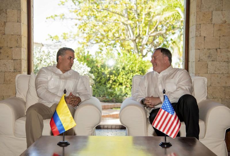 This handout picture released by the Colombian presidency shows Colombian President Ivan Duque (L) and US Secretary of State Mike Pompeo during a meeting in Cartagena, Colombia on January 2, 2019