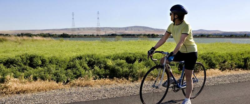 Senior Woman Stopping to Enjoy the Scenery in Eastern Washington State while on a Bike Ride