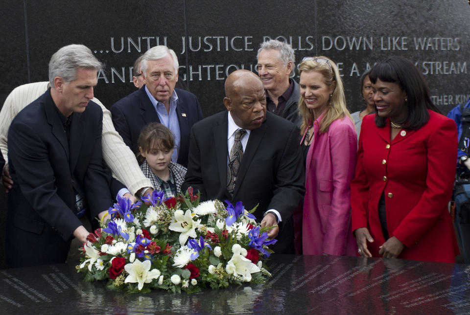 Lawmakers including House Republican Whip Kevin McCarthy, left, of California, House Democratic Whip Steny H. Hoyer, D-Md, (2nd from left), and U.S. Rep. John Lewis, D-Ga., center, place a wreath on the Civil Rights Memorial in Montgomery, Ala., Saturday, March 3, 2012. (Photo: Dave Martin/AP)