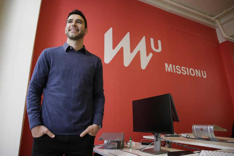 CORRECTS TO INCOME-SHARING AGREEMENT FROM PROFIT-SHARING AGREEMENT - In this photo taken April 27, 2017, founder Adam Braun poses at MissionU in San Francisco. MissionU, which began accepting its first applications last month, offers a one-year program in data analytics and business intelligence with an upfront tuition of $0. As part of a income-sharing agreement, MissionU students will be giving back 15 percent of their salary for three years after graduation, given that they make at least $50,000 per year. (AP Photo/Eric Risberg)