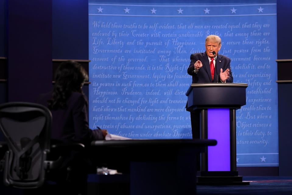 President Trump points at the moderator as he speaks onstage