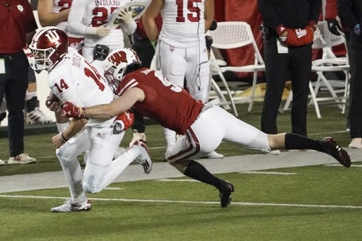 Wisconsin safety Scott Nelson tries to stop Indiana's Jack Tuttle during the second half of an NCAA college football game Saturday, Dec. 5, 2020, in Madison, Wis. Indiana won 14-6. (AP Photo/Morry Gash)