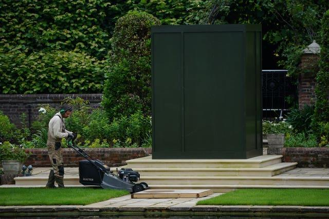 A gardener works in the Sunken Garden at Kensington Palace, London, the former home of Diana, Princess of Wales