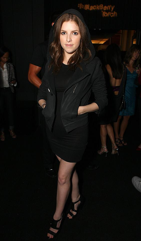 """Up In the Air"" cutie Anna Kendrick stayed warm by layering a black hoodie over her sleek Alice + Olivia LBD, and accessorized her outfit with Botkier ""Paige"" booties. Chris Weeks/<a href=""http://www.wireimage.com"" target=""new"">WireImage.com</a> - August 11, 2010"