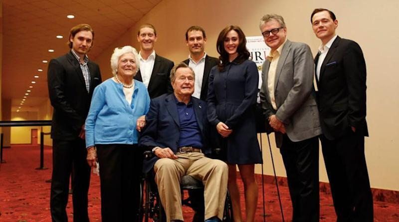 "Lind, center, said the former president ""touched"" her twice during this photo opp and that former first lady Barbara Bush was aware."