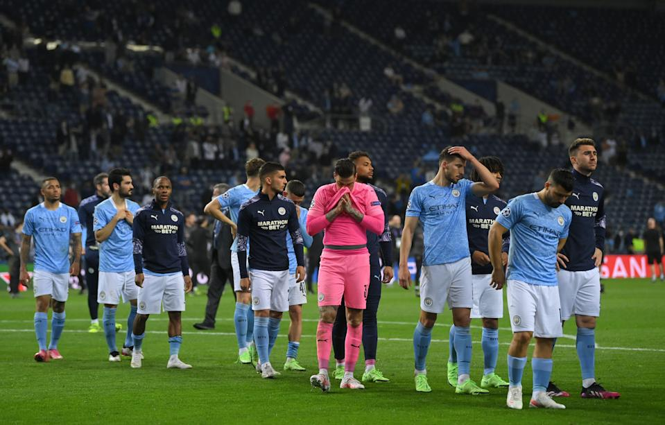 Manchester City players looking dejected after losing the Champions League final to Chelsea.