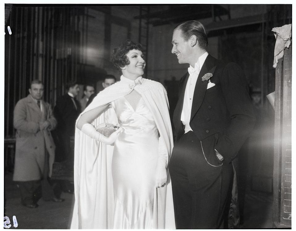 <p>The actor dressed to the nines in a black tuxedo with a red carnation in his lapel to film a Christmas benefit show. He was joined backstage by Claudette Colbert, who wore a white evening gown and cape. </p>