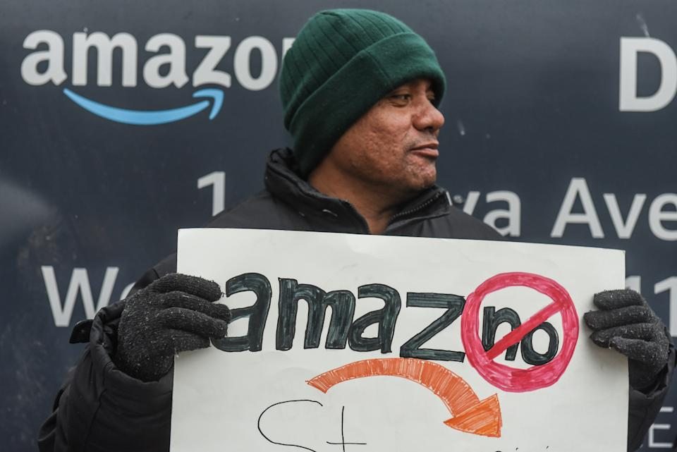Immigrant and labor activists participate in a rally outside of a Amazon distribution center on December 16, 2019 in the Queens borough of New York City. (Photo by Stephanie Keith/Getty Images)