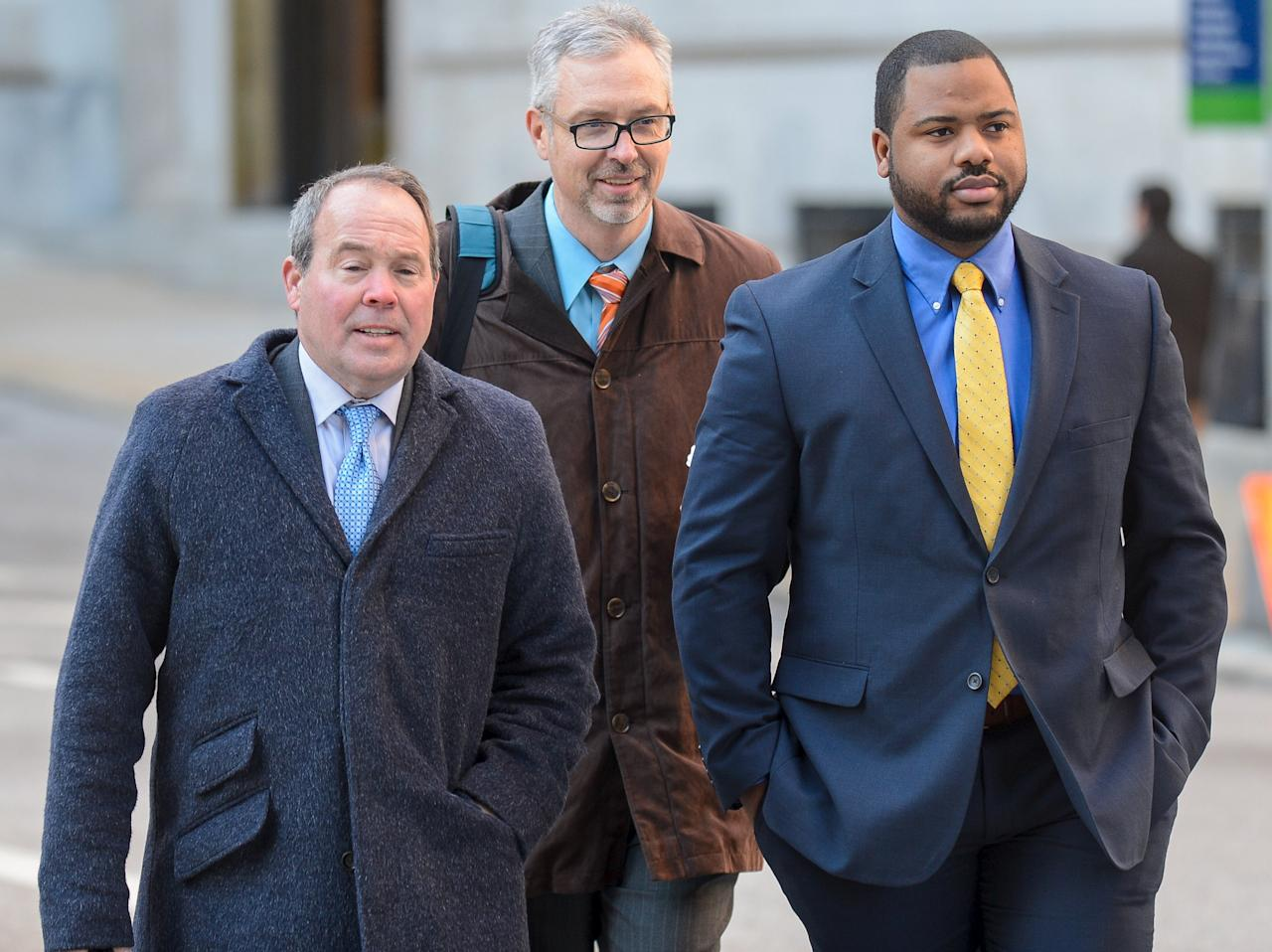 REFILE - CORRECTING IDENTITY OF ATTORNEYBaltimore Police Officer William Porter (R) with his attorneys Joseph Murtha (L) and Gary Proctor arrive at the courthouse for pretrial hearings in the case of Caeser Goodson in Baltimore, Maryland, January 6, 2016. A Maryland judge on Wednesday ordered Porter to testify against other officers charged in the death of detainee Freddie Gray. A lawyer for Porter said he would seek an appeals court injunction to block Porter from testifying against Officer Caesar Goodson Jr. and Sergeant Alicia White. REUTERS/Bryan Woolston